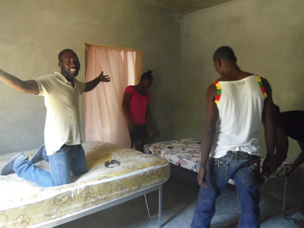 Jean Rony, Meline and Claude setting up the childrens beds
